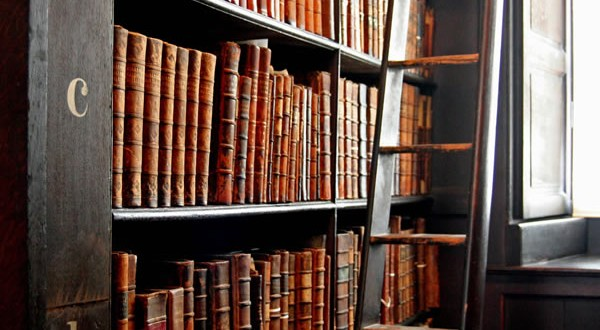 Trinity_College_Library-words_in_leather_and_wood